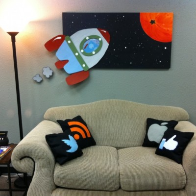 Couch and rocket painting