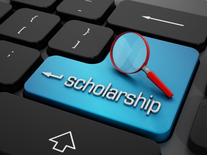 Scholarship word and magnifying glass on enter key