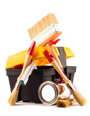 Can of paint with paintbrushes and toolbox isolated on white