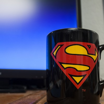 Superman Coffee Mug in front of Tim's Superman wallpaper