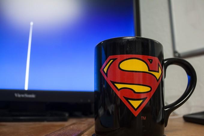 Superman Coffee Mug in front of Tim's Superman wallpaper