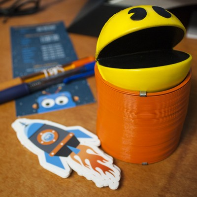 Pac Man Stress Ball, Slinky, and Rocket Stickers