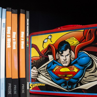 Tim's books and a Superman lunchbox