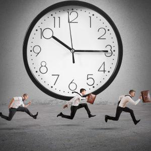Three men running by giant clock