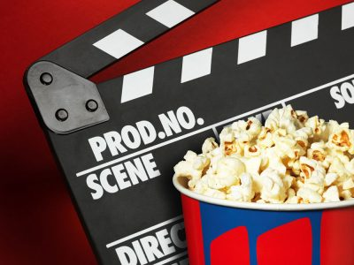 movie clapboard and popcorn, promoting blog articles
